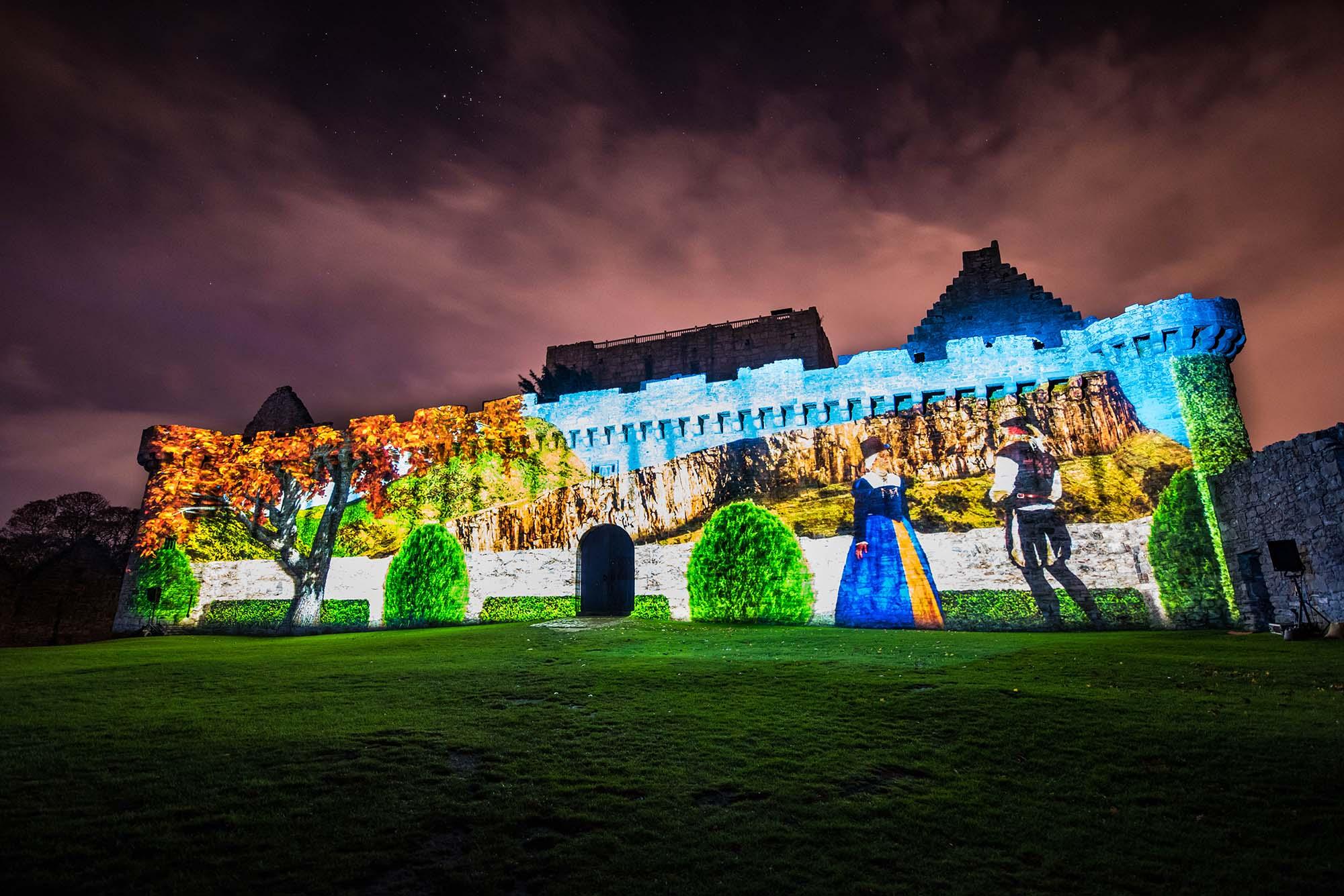 Spotlight on Mary, Projection Light Walk, on Craigmillar Main Wall