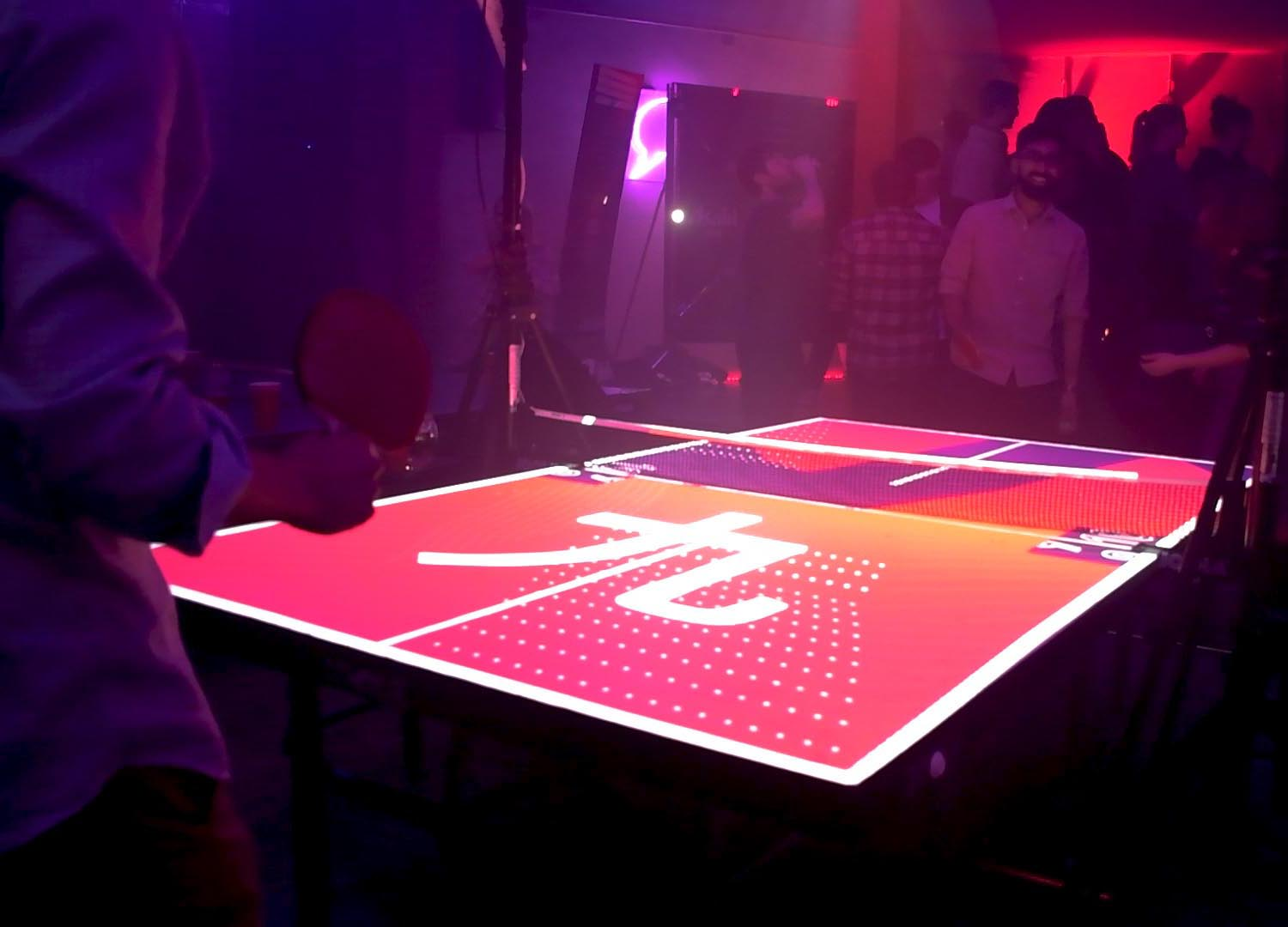 Cover Asahi Interactive Ping Pong Table, with players and projection mapping