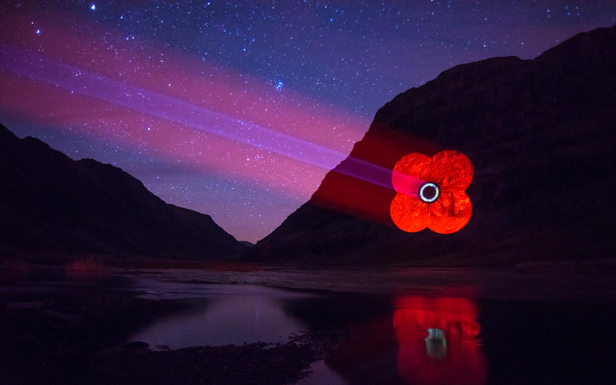 Poppy Scotland logo projected onto Mountain in Glencoe