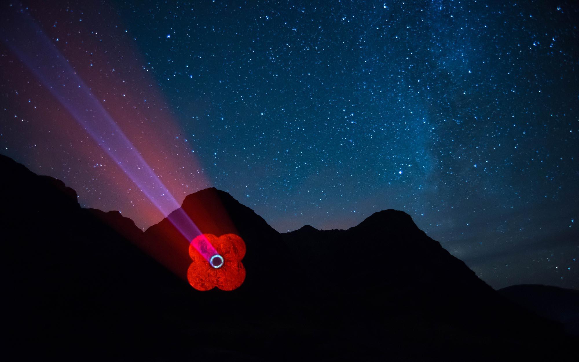 Poppy Scotland logo projected onto Mountain in Glencoe