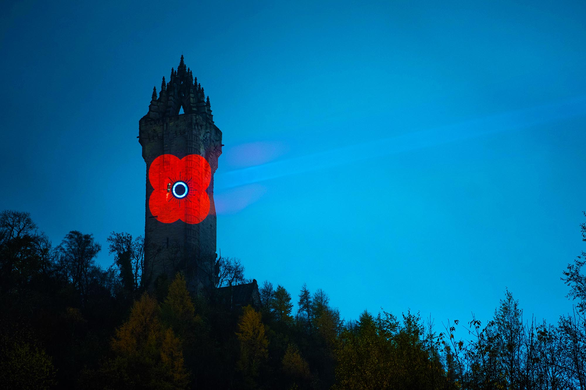 Poppy Scotland logo projected onto the National Wallace Monument