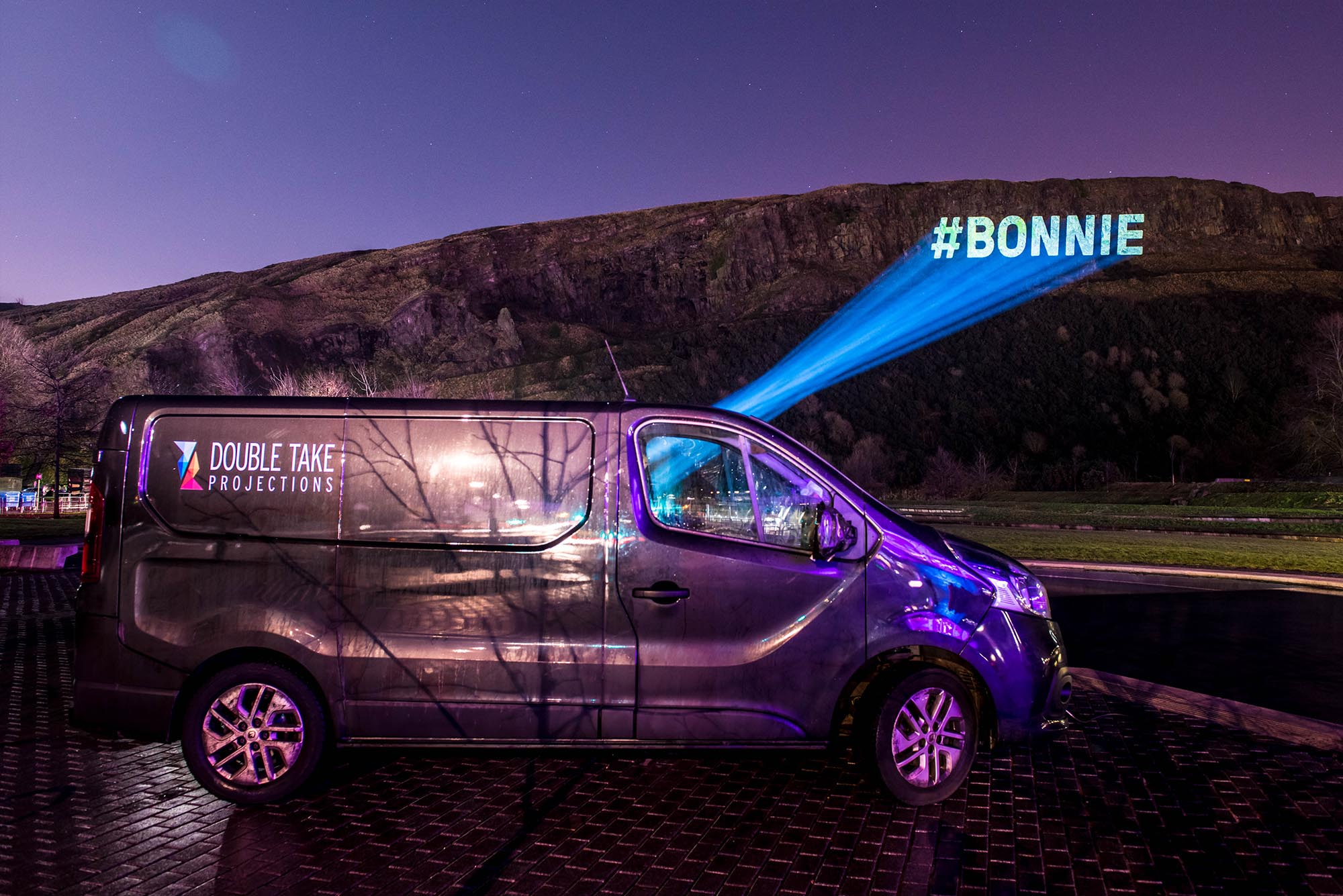 Torchlight Procession Projections, #bonnie beamed on Edinburgh Crags