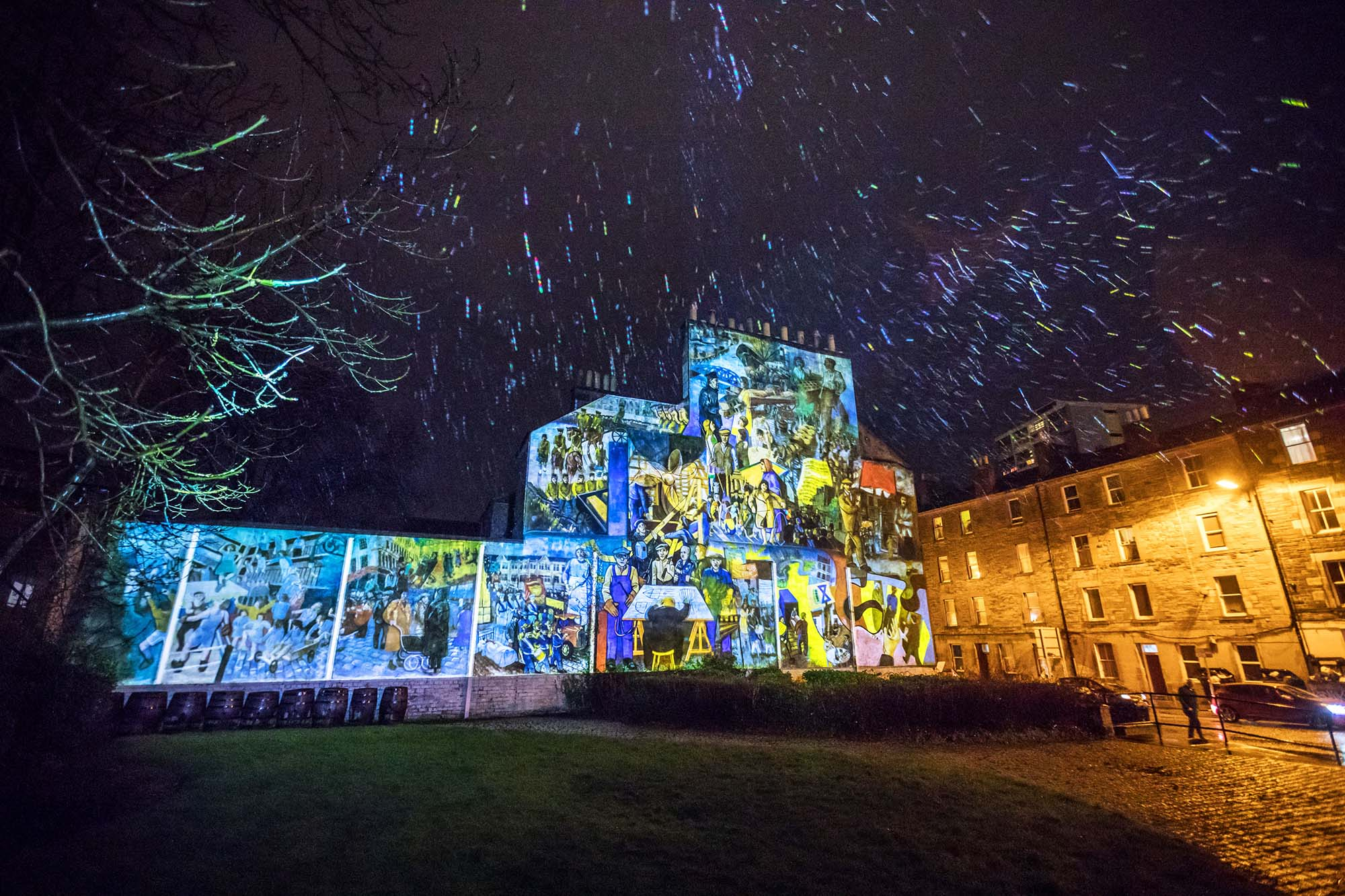 wide angle view of leith mural projection in the rain